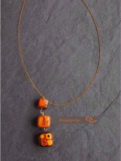 Collier orange en trio