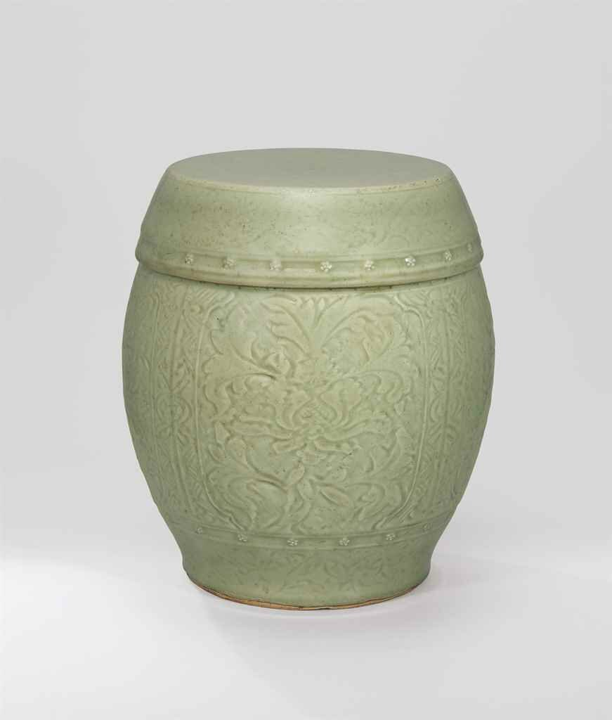 A carved Longquan celadon barrel-form stool, Ming Dynasty, 15th century