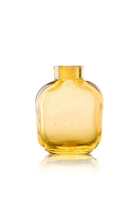 An amber glass bottle of flattened square shape. Photo Lyon & Turnbull