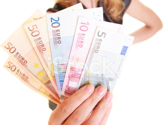 44728134-economy-finance-woman-holds-euro-currency-money