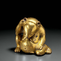 A superb gilt-bronze figure of a seated bear, china, western han dynasty (206 bc-ad 8)