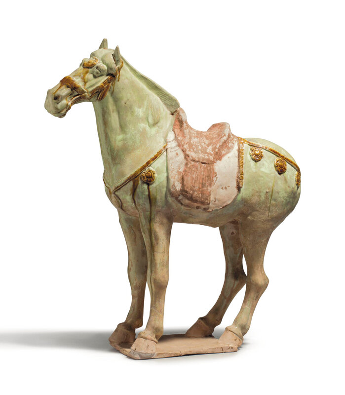 A straw and amber-glazed pottery figure of a horse, Tang dynasty (618-907)