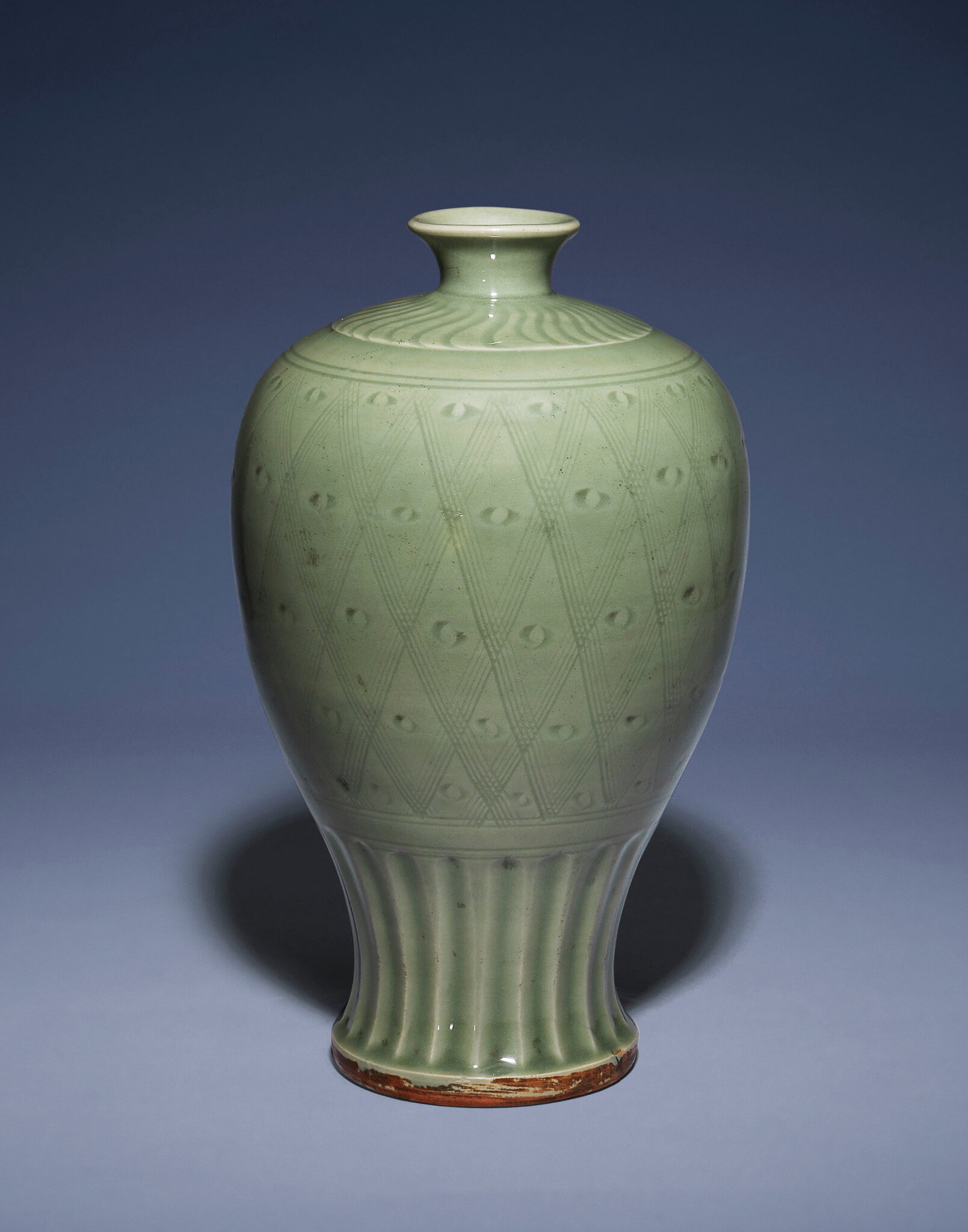 A carved Longquan celadon meiping, Ming dynasty, 14th-15th century