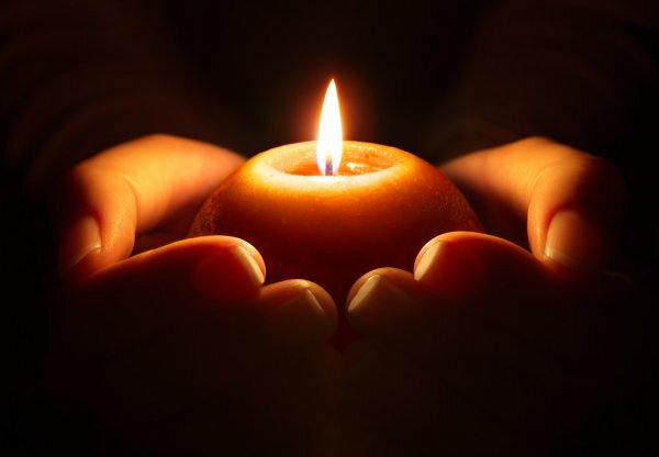 depositphotos_57491911-stock-photo-prayer-candle-in-hands