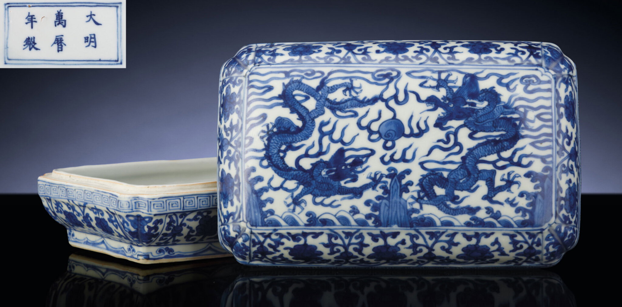 A fine and rare late Ming blue and white rectangular 'dragon' covered box, Wanli six-character mark within double-rectangles and of the period (1573-1619)