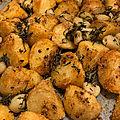 Pommes de terre à la harissa et à l'ail confit au four
