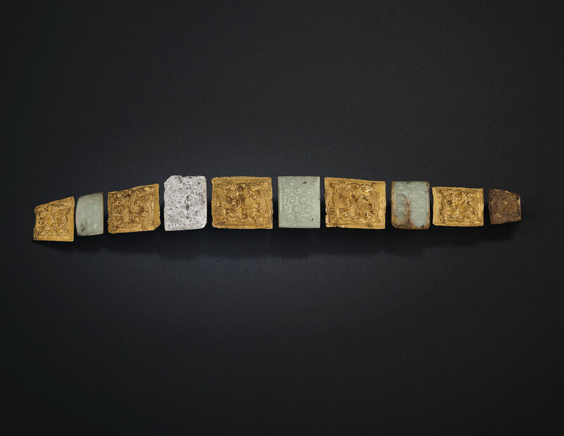 2019_NYR_18338_0510_001(a_very_rare_set_of_gold_and_jade_garment_hook_plaques_eastern_zhou_dyn)