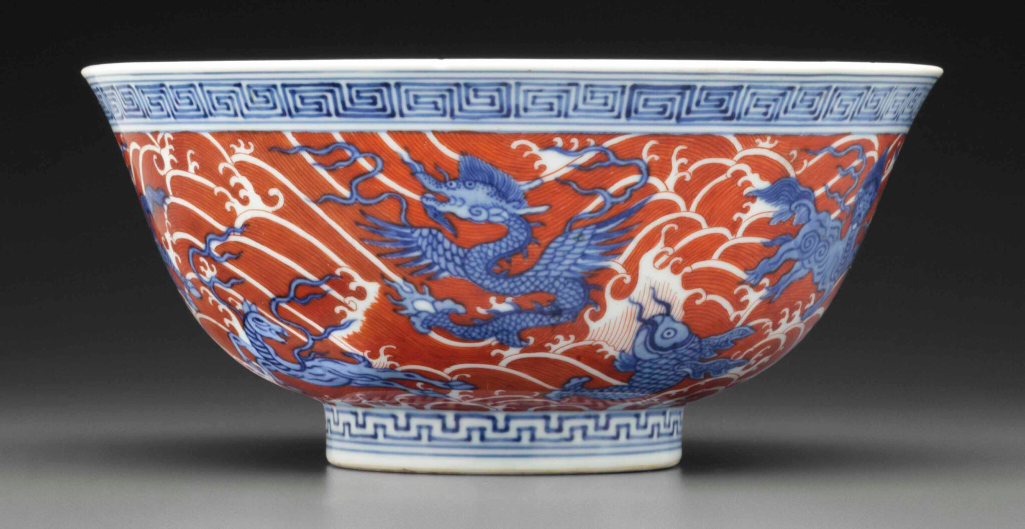 An iron-red-decorated blue and white 'Sea creatures' bowl, Qianlong six-character seal mark in underglaze blue and of the period (1736-1795)
