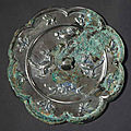 A silvery-grey bronze eight-lobed mirror, Tang dynasty (618-907)