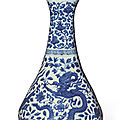 A finely painted blue and white 'dragon and phoenix' garlic-mouth bottle vase, wanli mark and period (1573-1619)