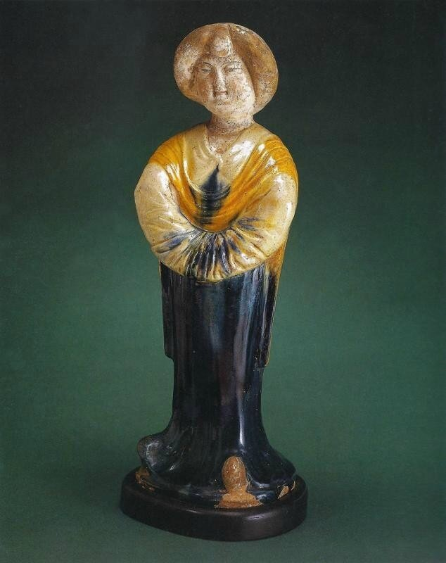 an eighth-century, Tang dynasty figure of a standing court lady