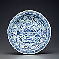 An extremely rare large blue and white barbed-rim 'Mandarin Ducks' charger, Yuan dynasty (1279–1368)