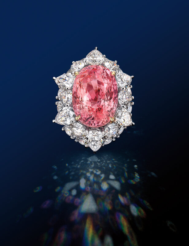 A 21.20-carat unheated Sri Lankan Padparadscha Sapphire and Diamond Ring