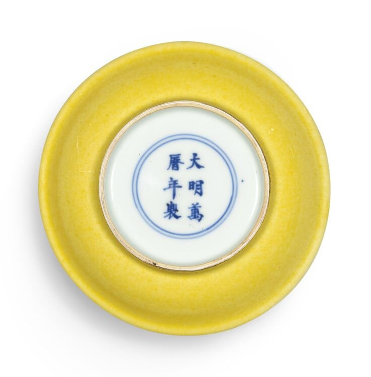 A small yellow-glazed dish, Mark and period of Wanli