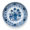 A blue and white 'lotus bouquet' saucer dish, yongzheng mark and period (1723-1735)