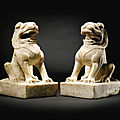 A rare pair of marble seated lions, tang dynasty (618-906)