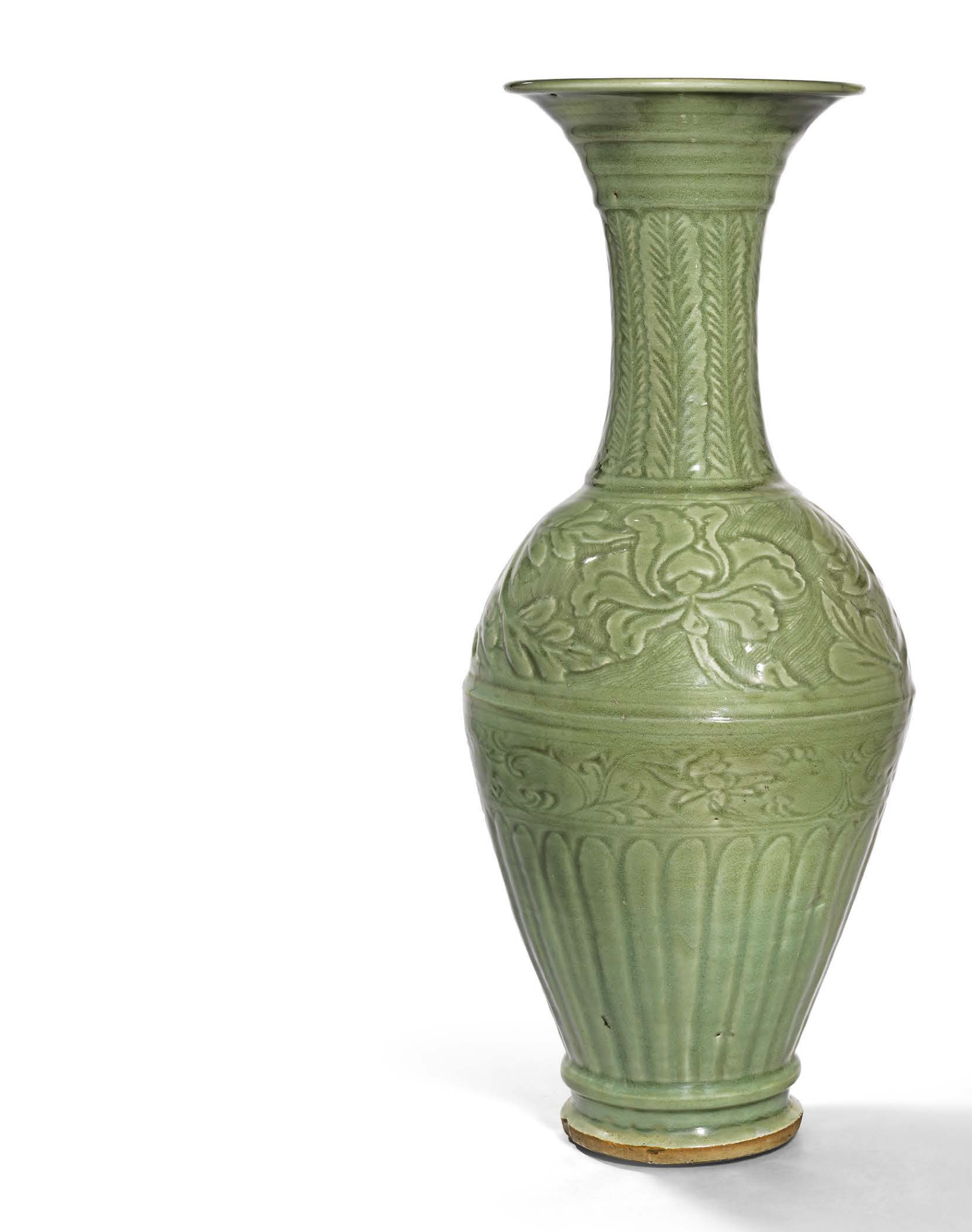 A large carved Longquan celadon trumpet-necked vase, Yuan dynasty (1279-1368)