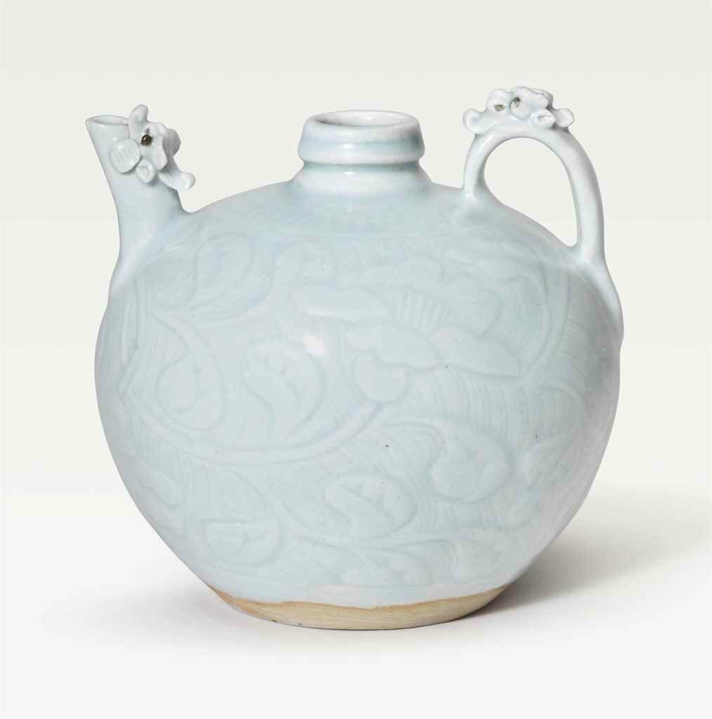 A very rare and finely carved Qingbai 'Dragon' ewer, Southern Song Dynasty (1127-1279)