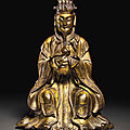 A small gilt-bronze figure of a seated daoist immortal, ming dynasty (1368-1644)