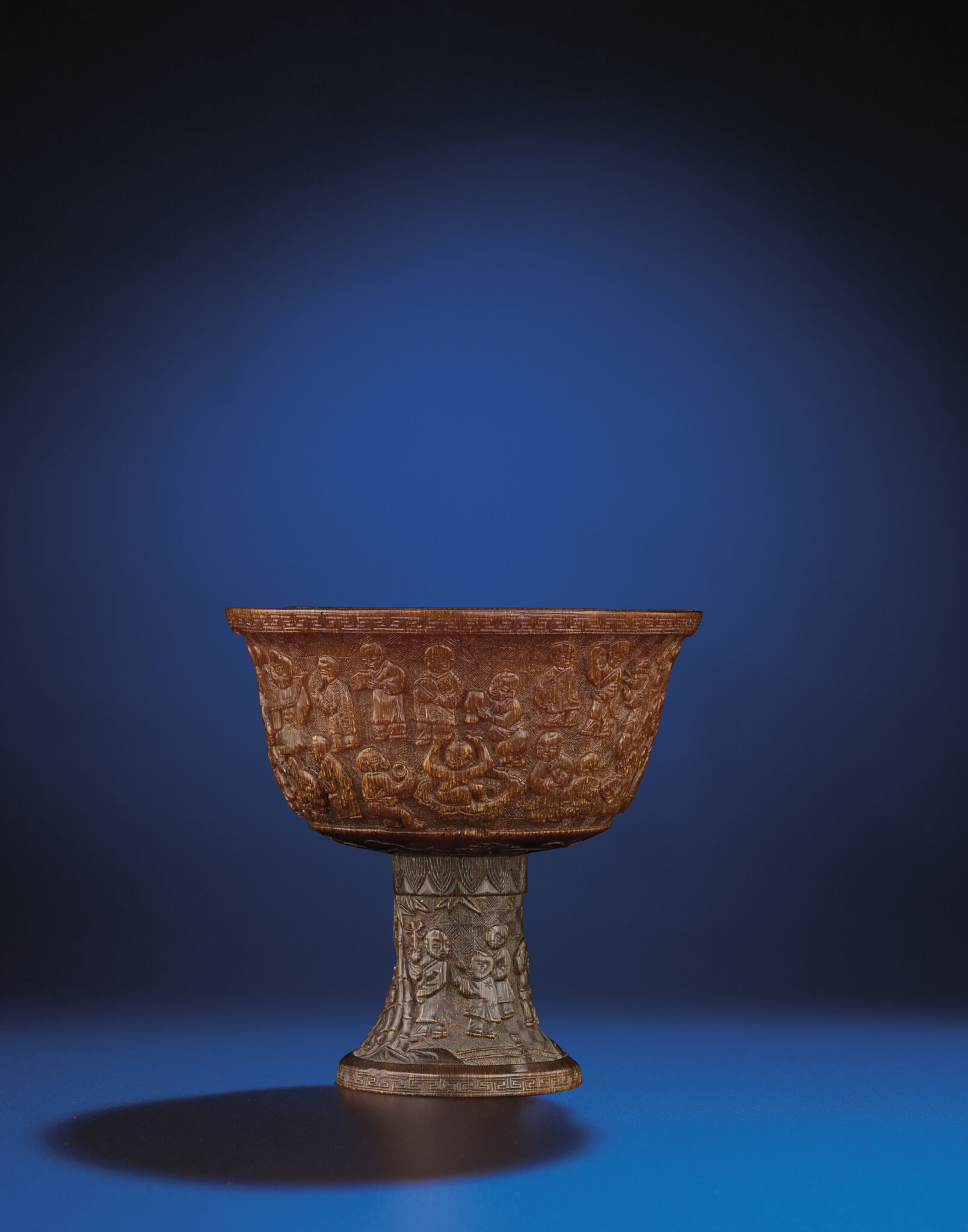 A rare and finely carved rhinoceros horn 'Hundred boys' stem cup, Late Ming-early Qing dynasty, 17th century