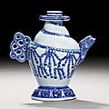 A blue and white 'conch' water-dropper, ming dynasty, mid-15th century
