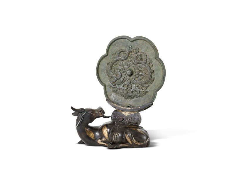A bronze 'twin dragon' mirror, Song dynasty, and a parcel-gilt bronze mirror stand, Ming dynasty