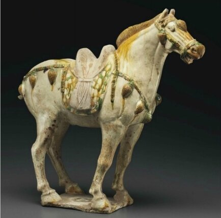 A sancai-glazed pottery figure of a horse, Tang dynasty (AD 618-907)