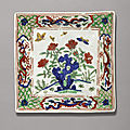 A wucai 'flower and butterfly' dish, jiajing mark and period (1522-1566)