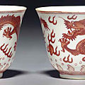 A pair of small iron-red-decorated 'dragon' wine cups, tongzhi six-character marks and of the period (1862-1874)