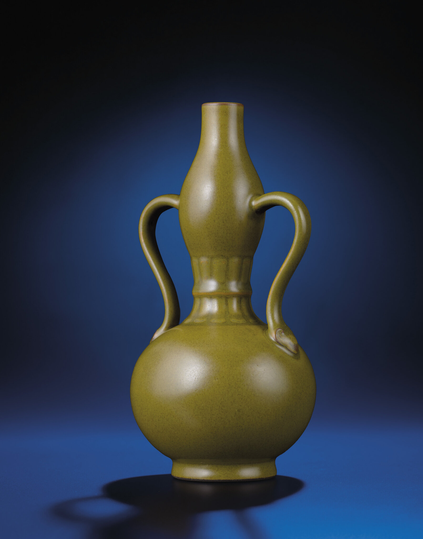 A fine teadust-glazed double-gourd vase, Qianlong impressed six-character seal mark and of the period (1736-1795)