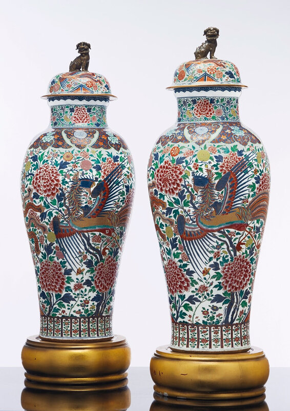 A pair of Rose-Imari 'Soldier' vases and covers, YongzhengEarly Qialong period