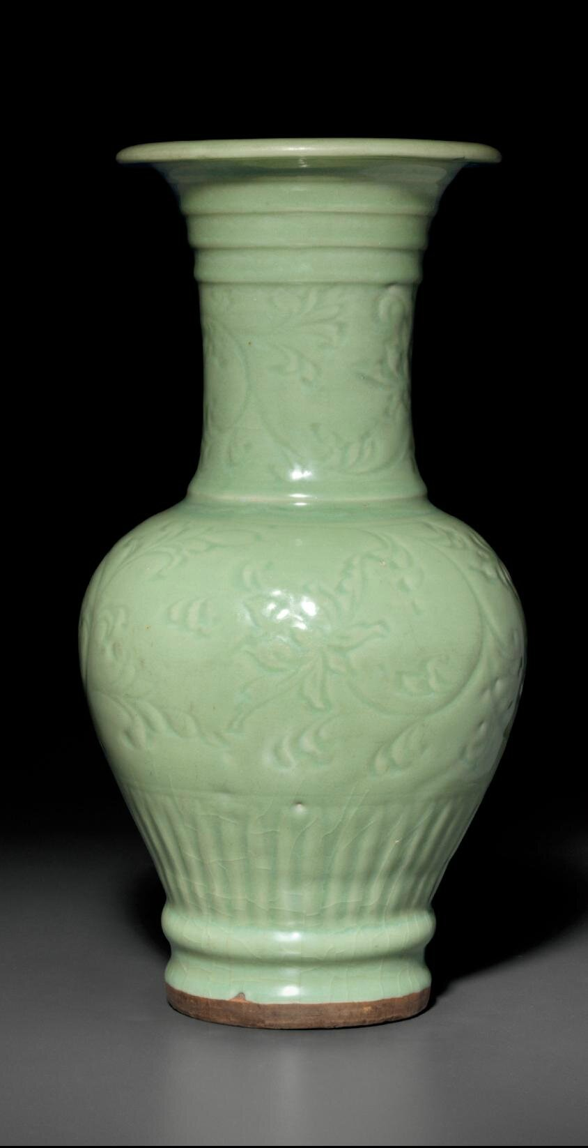 A carved Longquan celadon  'phoenix-tail' vase, Ming dynasty, 14th-15th century