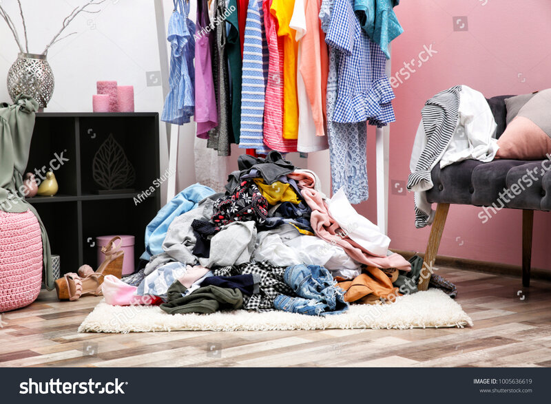 stock-photo-messy-dressing-room-interior-with-clothes-rack-1005636619