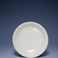 An early MIng white-glazed dish, Xuande incised six-character mark within a double circle and of the period (1426-1435)