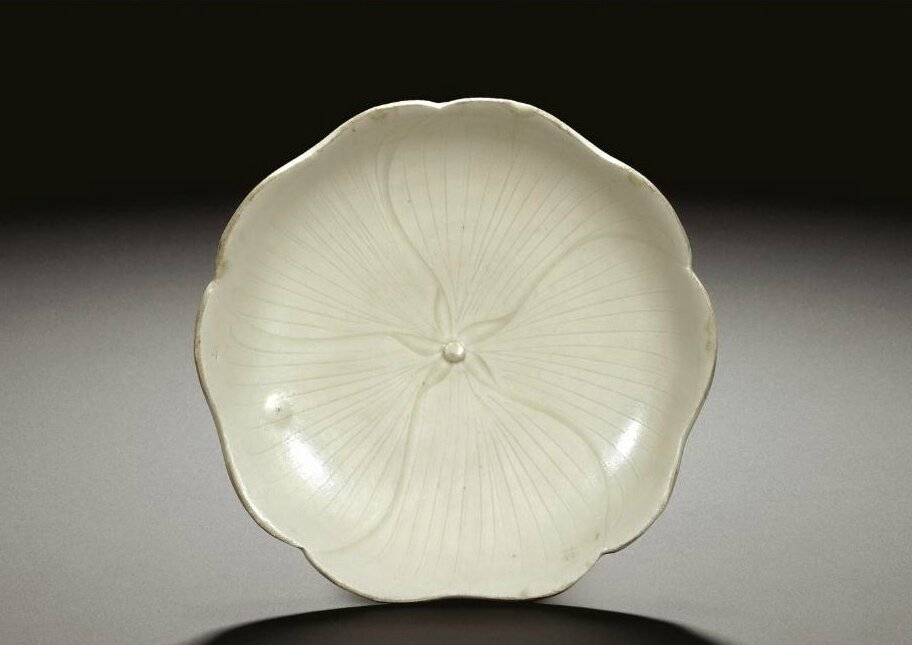 A rare 'Ding' incised 'mallow' dish, Northern Song dynasty (960-1127)