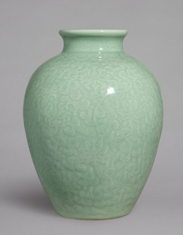A fine and rare moulded celadon-glazed 'lotus' jar, seal mark and period of Qianlong (1736-1795)