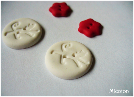 boutons fimo chat blanc