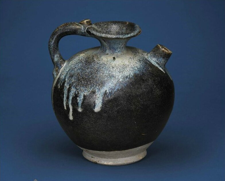 A Henan black-glazed blue-splashed ewer, Tang dynasty (618-907)