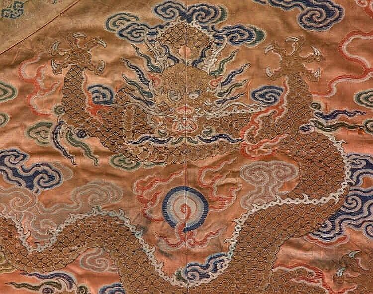 A coral ground silk Tibetan chuba, tailored from 18th century Chinese kesi5
