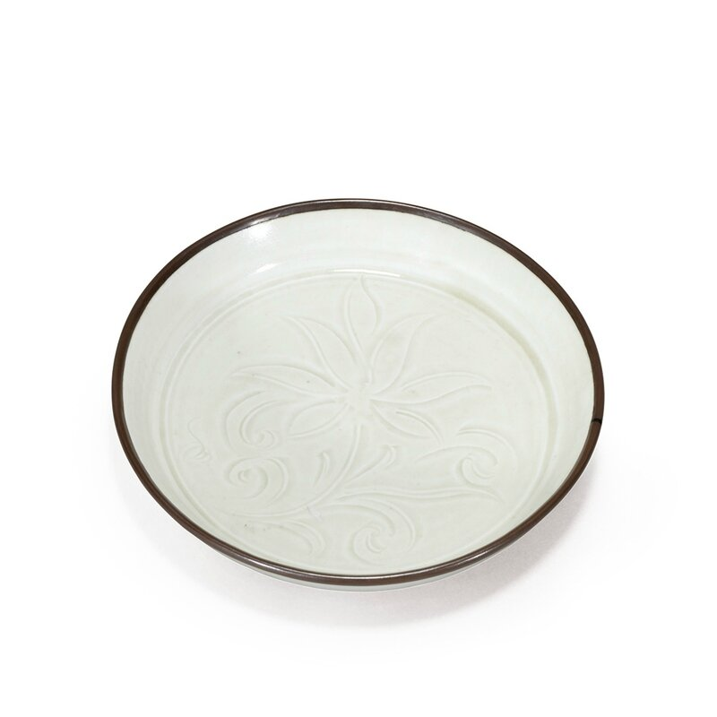 A rare Dingyao white glazed brushwash carved with flowers, Song Dynasty