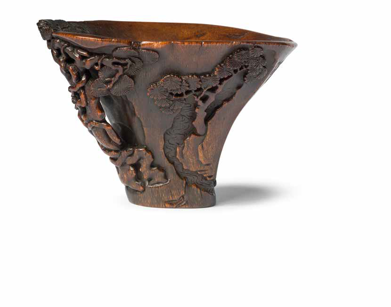 A rare 'scholar and pine' rhinoceros horn libation cup, 17th century