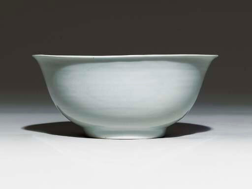 A large white-glazed incised bowl, underglaze-blue Jiajing six-character mark within a double circle and of the period (1522-1566)