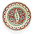 An iznik polychrome pottery dish with a red ground, turkey, circa 1570-75