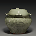 A rare Longquan celadon carved jar and cover, Yuan dynasty, 14th century