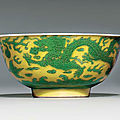 A green and yellow incised 'dragon' bowl, underglaze-blue kangxi six-character mark within double-circles and of the period