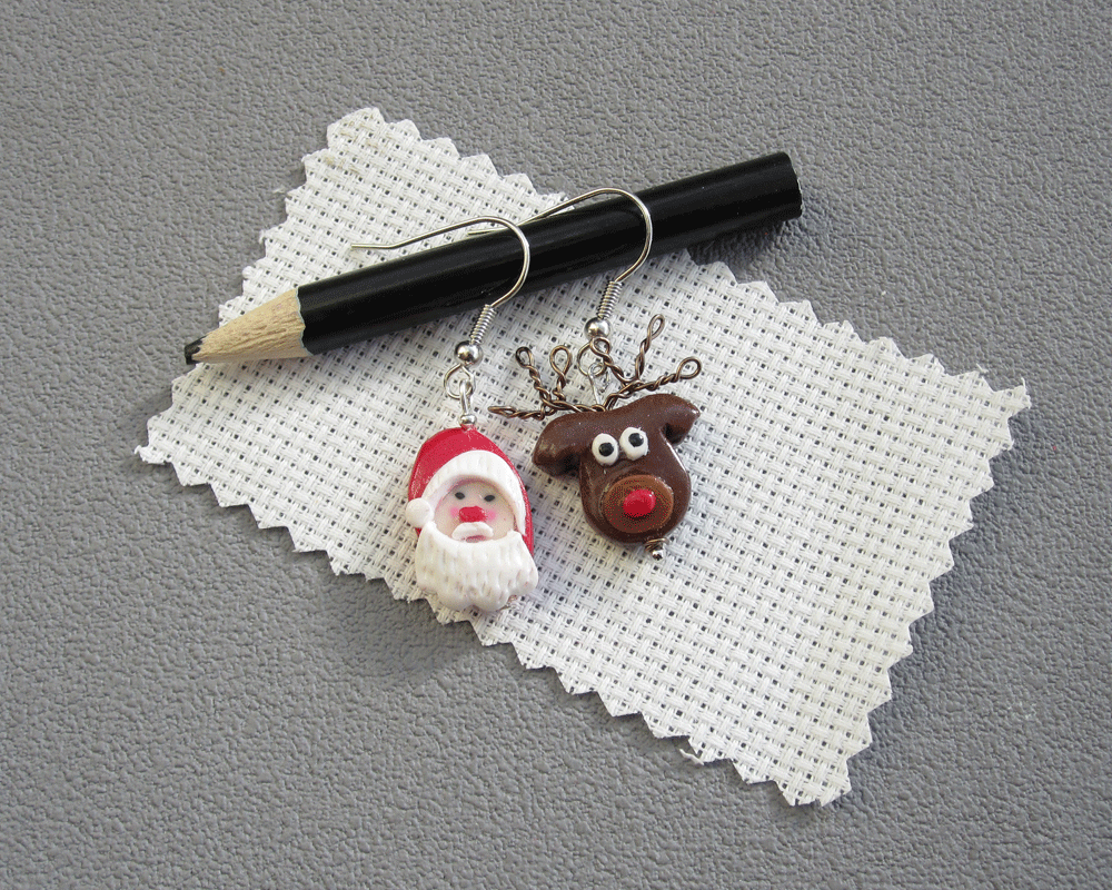 Boucles têtes de Père Noel et son Renne