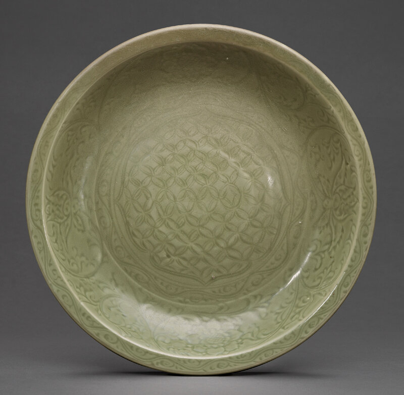 A large carved Longquan celadon charger, Ming dynasty, 15th century