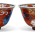 A rare pair of underglaze blue and gilt-decorated kinrande 'chilong' bowls, jiajing six-character marks and of the period