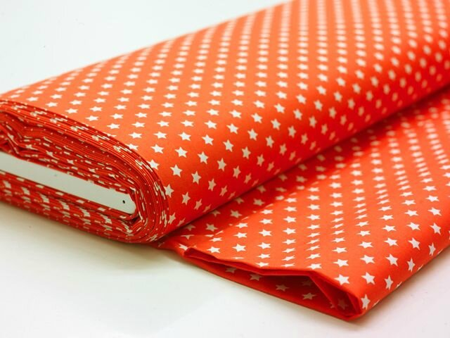 tissu orange à étoiles blanches